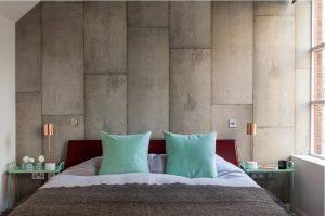 Habitacion con papel pintado con textura de hormigón
